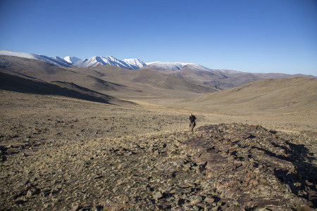 bayan Ulgii, Mongolia, 1st October 2015: hiker in a mountains of remote Mongolia Stok Fotoğraf