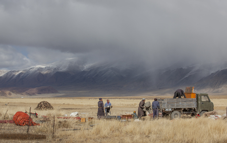 bayan Ulgii, Mongolia, 29th September 2015: mongolian kazakh nomad people packing their yurt into a car to make a move to more sheltered place for winter season Editöryel