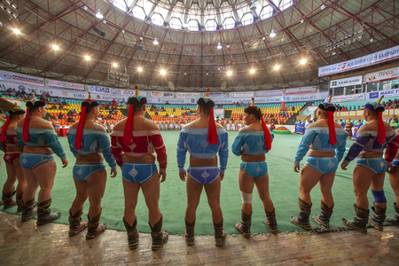Ulannbaatar, Mongolia, 27th September 2015: mongolian wrestlers lined up ready for a match Editorial