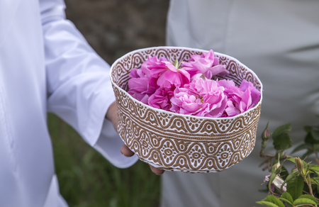 omani hat called Kuma filled with rose petals that will be used for making rose water