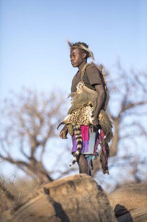 Lake Eyasi, Tanzania, 11th September 2019: Young Hazabe man in nature
