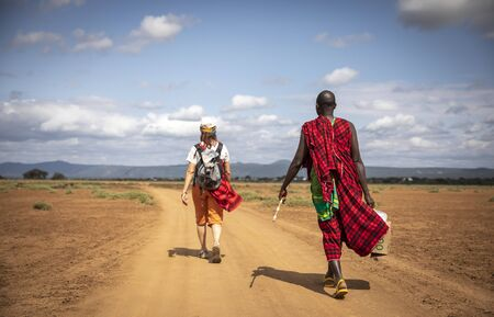 hikers on a road in africa