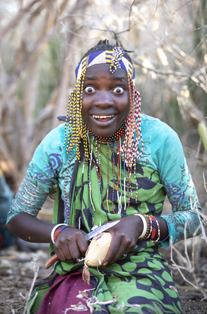 Lake Eyasi, Tanzania, 12th September 2019: Hadzabe woman diffing tuber plants for a eventing meal