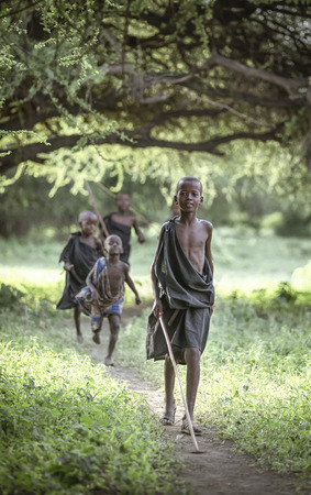 Same, Tanzania, 4th June, 2019:   Maasai  boys dressed in black ready for their 'right of passage' ceremony that takes them to the next stage in their life. They were circumcised the morning after and became maasai warriors Редакционное