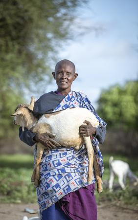 same, Tanzania, 4th June 2019: maasai woman with her goat Editorial