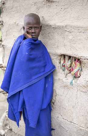 Same, Tanzania, 5th June, 2019:  Maasai boy in front of his home Editorial