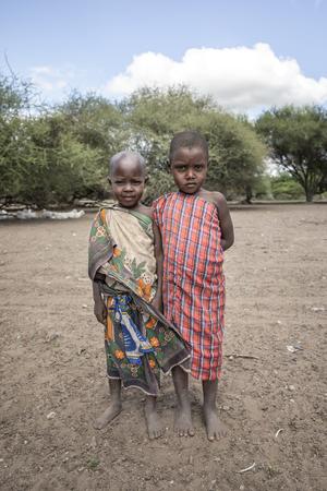 Same, Tanzania, 4th June 2019: young maasai friends in their home village Editorial