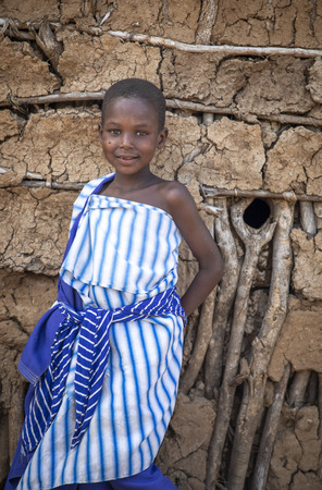 Same, Tanzania, 6th June, 2019:  Beautiful Maasai girl in traditional outfit