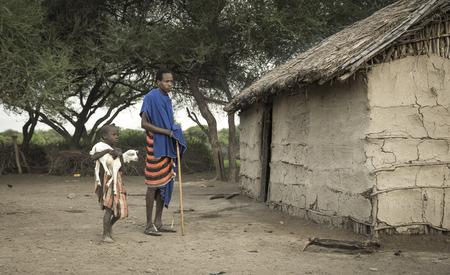 Same, Tanzania, 4th June, 2019:   Maasai  boy carrying a baby goat