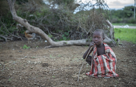 Same, Tanzania, 4th June, 2019:  Maasai boy in his home boma (village) Editorial