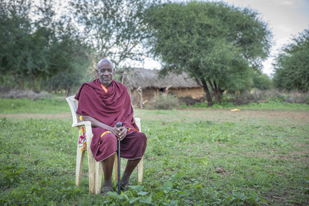 Same, Tanzania, 6th June, 2019:  old Maasai man in traditional outfit resting