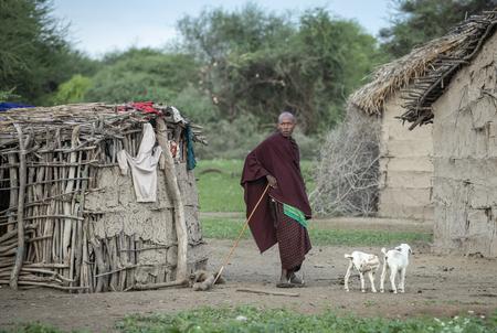 Same, Tanzania, 4th June, 2019:  Maasai men chatting at their home in their boma (village)