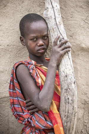 Same, Tanzania, 5th June, 2019:  young Maasai in front of her home Editorial