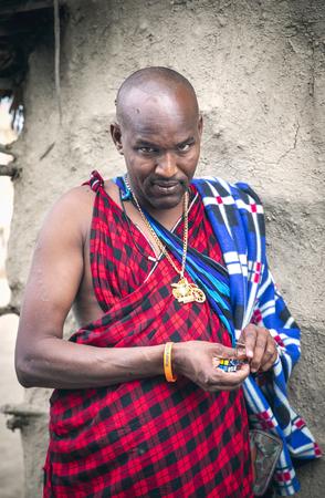 Same, Tanzania, 6th June, 2019:  Maasai man playing with his toy key ring