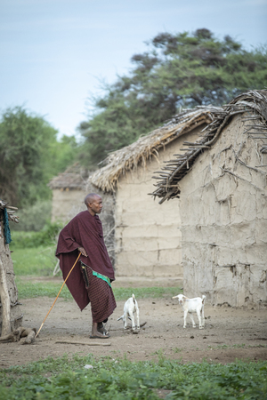 Same, Tanzania, 4th June, 2019:  Maasai man restring outside his home Editorial