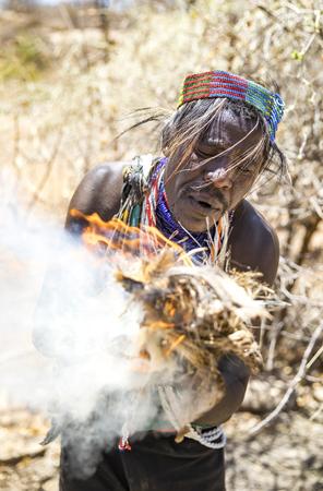 lake Eyasi, Tanzania, 11th September 2019: Hadzabe man made fire