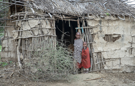 Same, Tanzania, 4th June, 2019:  Maasai kids at the door of their home in their boma (village)