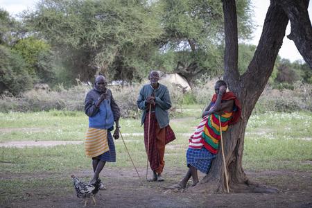 Same, Tanzania, 4th June, 2019: Maasai men resting a socialising in their boma Editorial