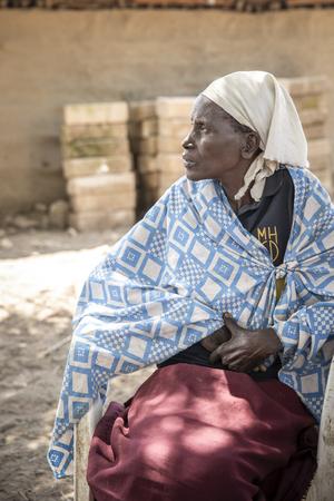 Same, Tanzania, 4th June 2019: maasai woman resting
