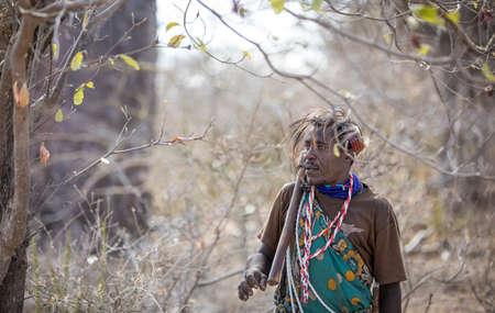 Lake Eyasi, Tanzania, 11th September 2019: Hadzabe man in a cave