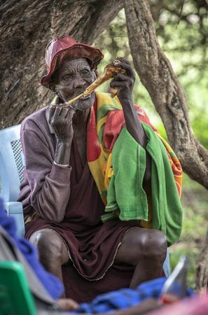 same, Tanzania, 5th June 2019: old man chewing on a bone