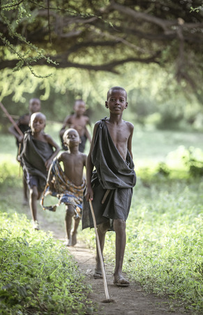 Same, Tanzania, 4th June, 2019: Maasai boys dressed in black ready for their 'right of passage' ceremony that takes them to the next stage in their life. They were circumcised the morning after and became maasai warriors