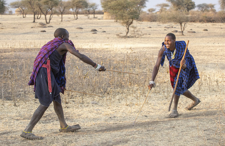 Arusha, Tanzania, 7th September 2019: maasai warriors practicing fencing masai style