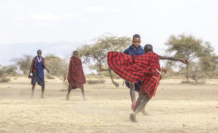Arusha, Tanzania, 7th September 2019: maasai men playing football
