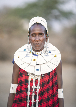 Arusha, Tanzania, 7th September 2019: beautiful maasai women in traditional clothing, wearing full jewelry
