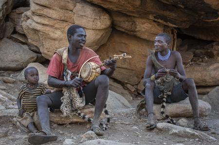 Lake Eyasi, Tanzania, 11th September 2019: Hadzabe men resting and singing in a shade