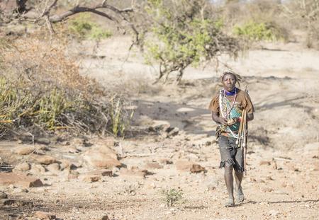 Lake Eyasi, Tanzania, 11th September 2019: Hadzabe men out hunting - for birs, rodens, honey or game Editorial