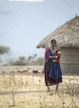 Arusha, Tanzania, 7th September 2019: beautiful maasai woman resting outside his home