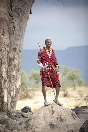 Arusha, Tanzania, 7Th September 2019: Maasai warrior in a landscape of northern Tanzanian savannah Editorial