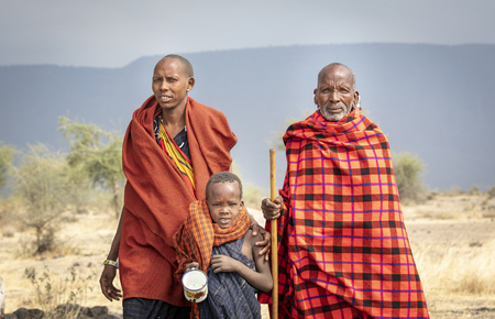 Arusha, Tanzania, 7Th September 2019: three generations of maasai men in nature of northern Tanzania Editorial