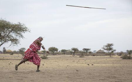 maasai man throwing a spear Фото со стока