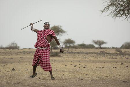 maasai man throwing a spear