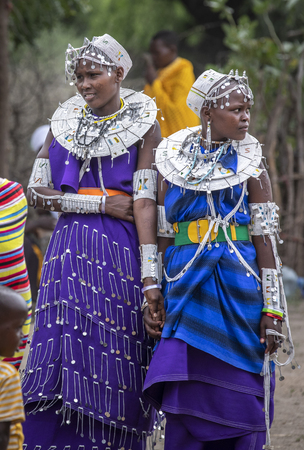same, Tanzania, 5th June 2019: young maasai ladies dressed for a celebration