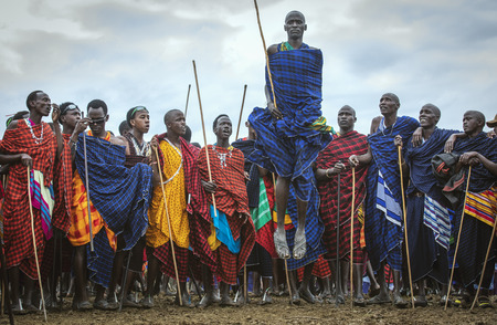 Same, Tanzania, 5th June, 2019: young  Maasai warrior in full traditional party outfit, jumping with pride Editorial