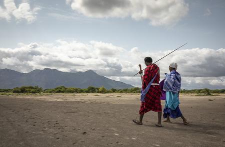 Same, Tanzania, 8th June, 2019:  Maasai people walking in a savannah