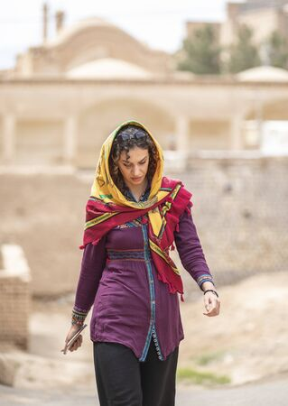 young beautiful iranian lady on the streets of an old village in Iran
