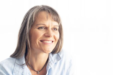 portrait of a middle aged woman with grey hair Imagens