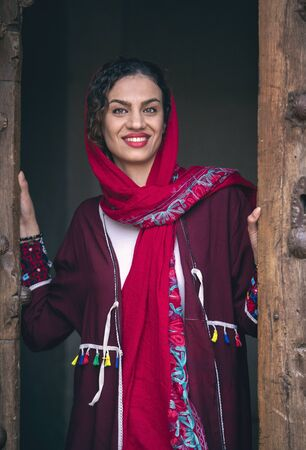 young beautiful iranian lady dressed in red traditional dress in  in Kashan Фото со стока
