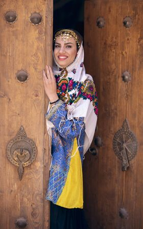 oung beautiful Iranian lady in traditional clothing in a traditional village of Abyaneh