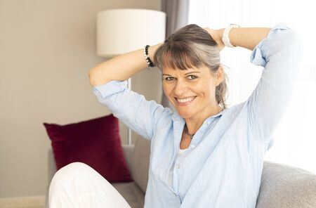 portrait of a middle aged woman with grey hair Фото со стока