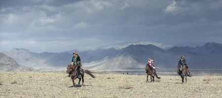 bayan Ulgii, Mongolia, 4th October 2015: kazakh eagle hunter in alandscape of western Mongolia Редакционное