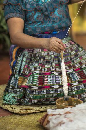 mayan woman preparing yarn for weaving fabrics