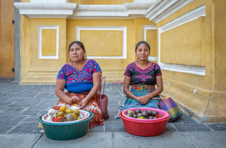 Antigua, guatemala, 3rd March 2020: Mayan ladies selling fruits on the street