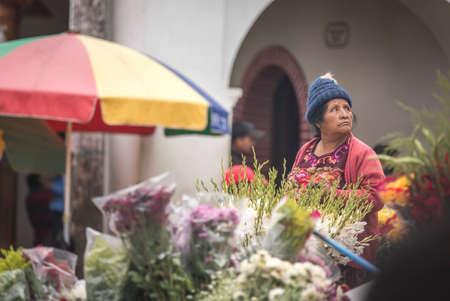 chichicastenango, Guatemala, 27th February 2020: mayan women at a flower market