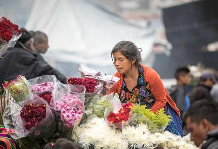 chichicastenango, Guatemala, 27th February 2020: mayan woman selling flowers at a market