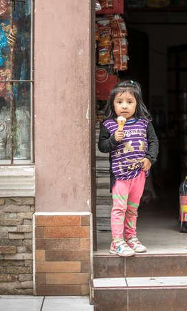 Panajachel, Guatemala, 25th February 2020, little mayan girl with an ice cream